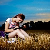 girl writing on a field